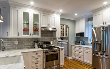 <Kitchens by Frankie White Kitchen with Glass Cabinets and Stainless Steel Appliances>